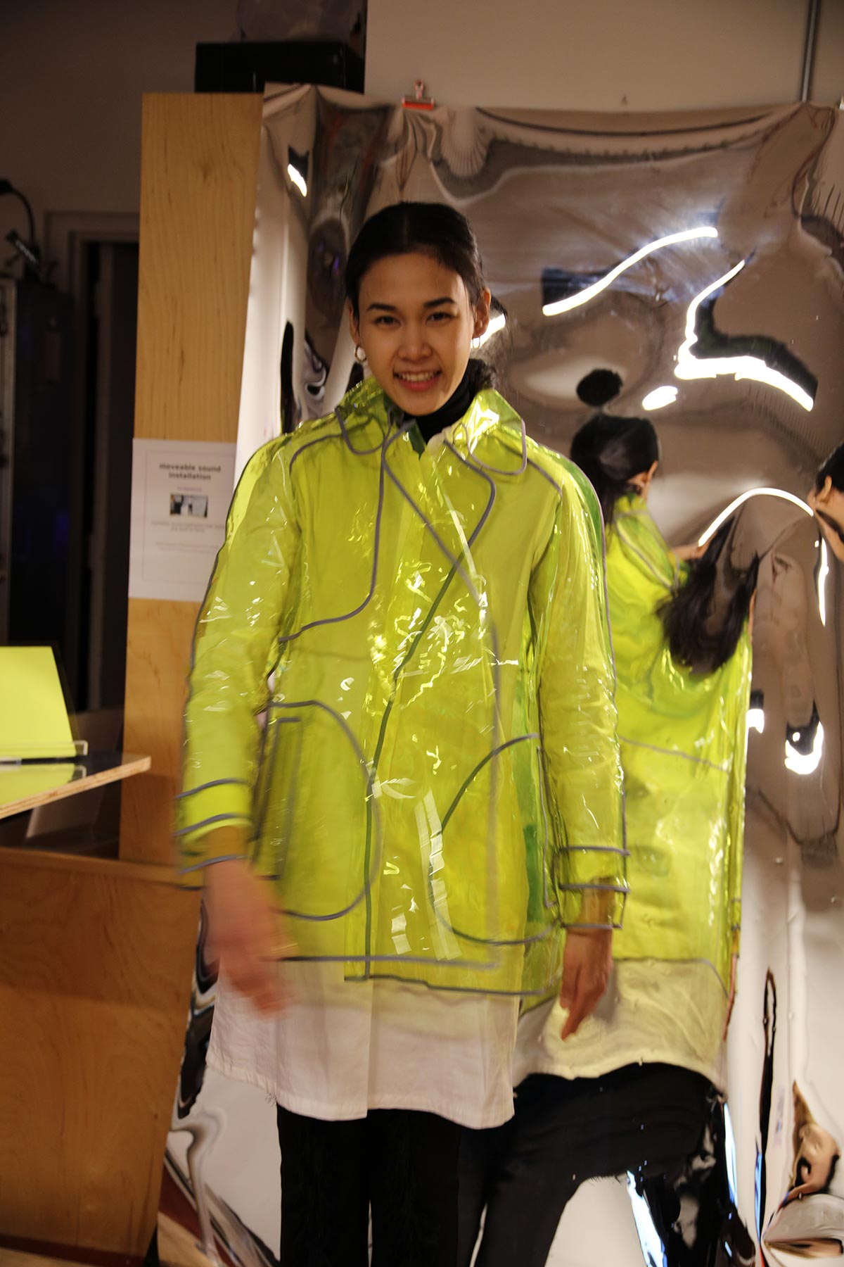 a woman wearing a fluorescent plastic raincoat