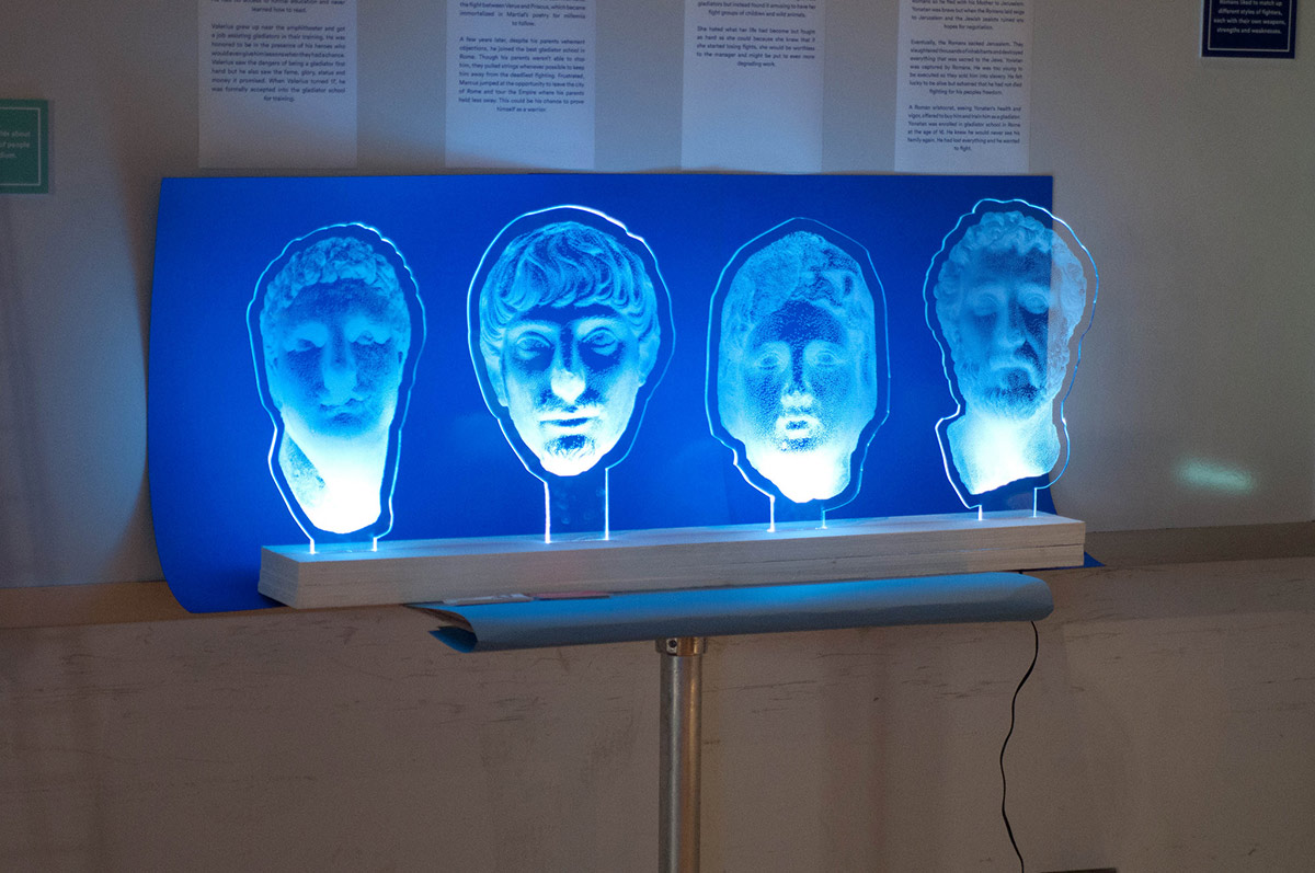 ancient faces projected onto acrylic