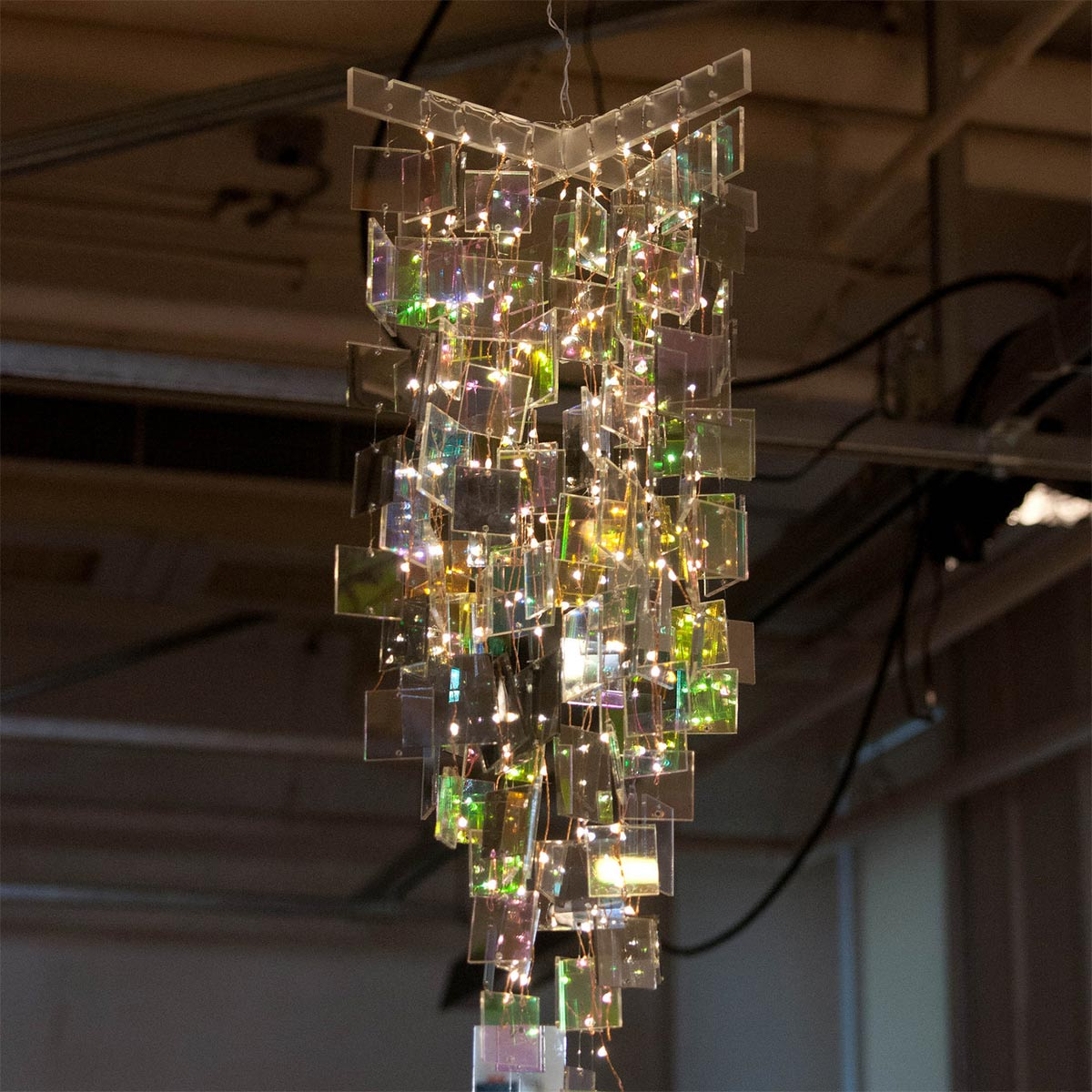 an acrylic chandelier lit up by LED's