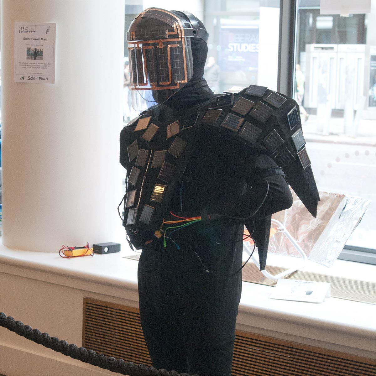 a person dressed with a mask and wings covered in solar panels