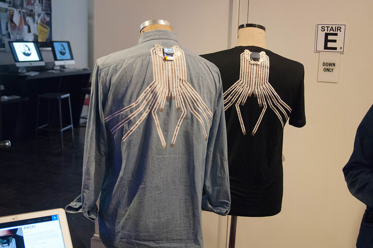 2 shirts with conductive thread sensors on the back