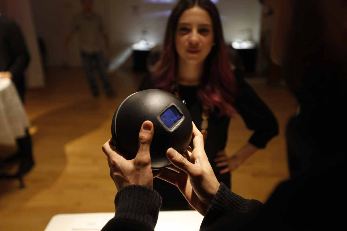 a black ball with a small video screen