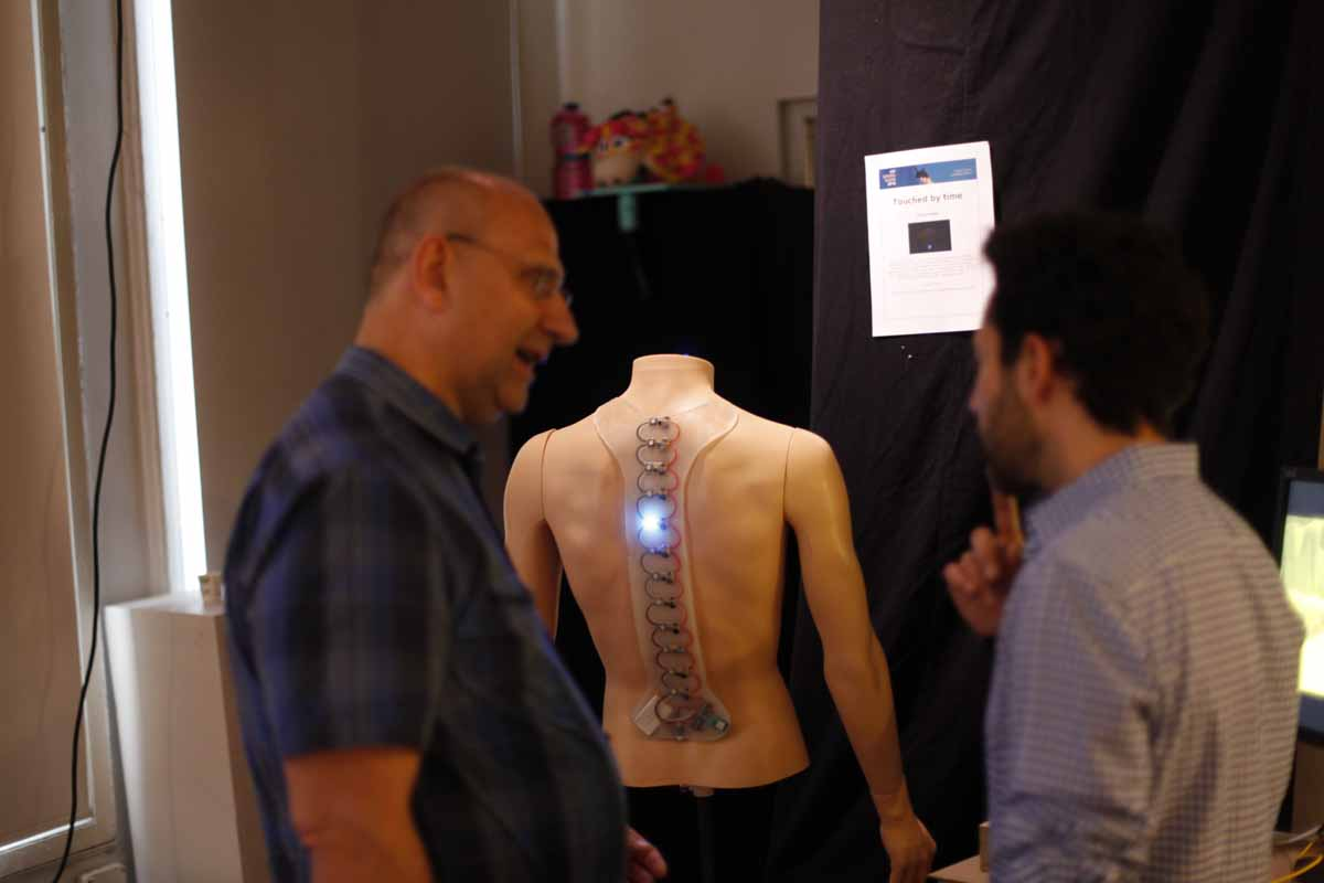 a wearable of lightup sensors along the spine of a headless mannequin