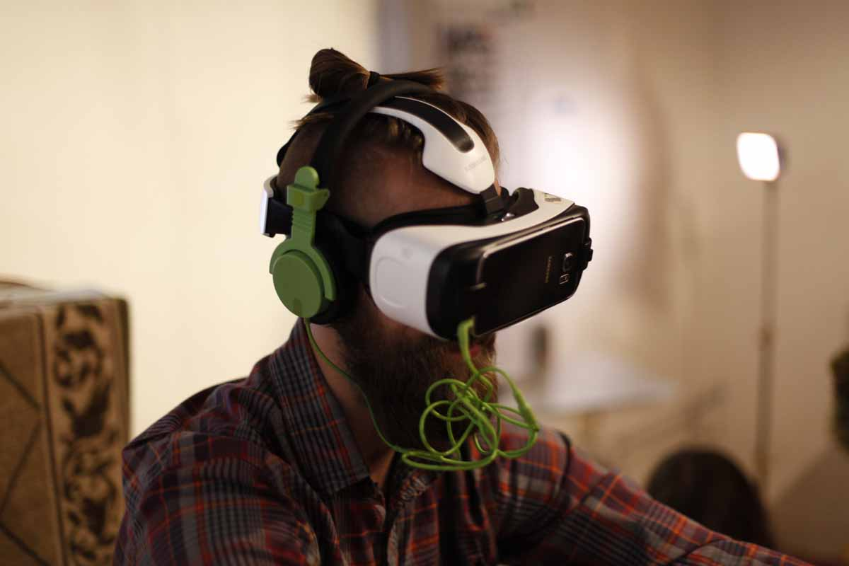 a man wearing VR goggles and headphones
