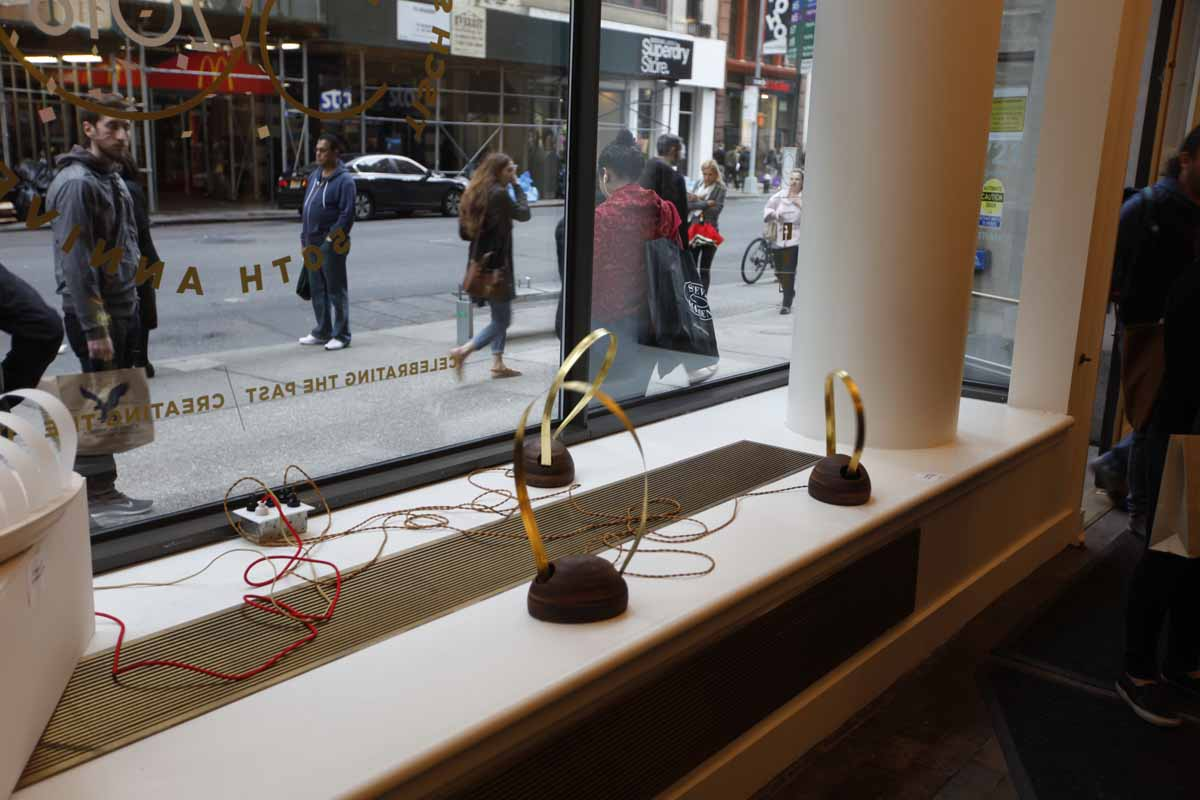 a window display showing vibrating sculptures