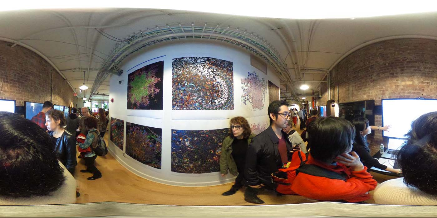 a 360 image of the hallway and people standing by projects at the show