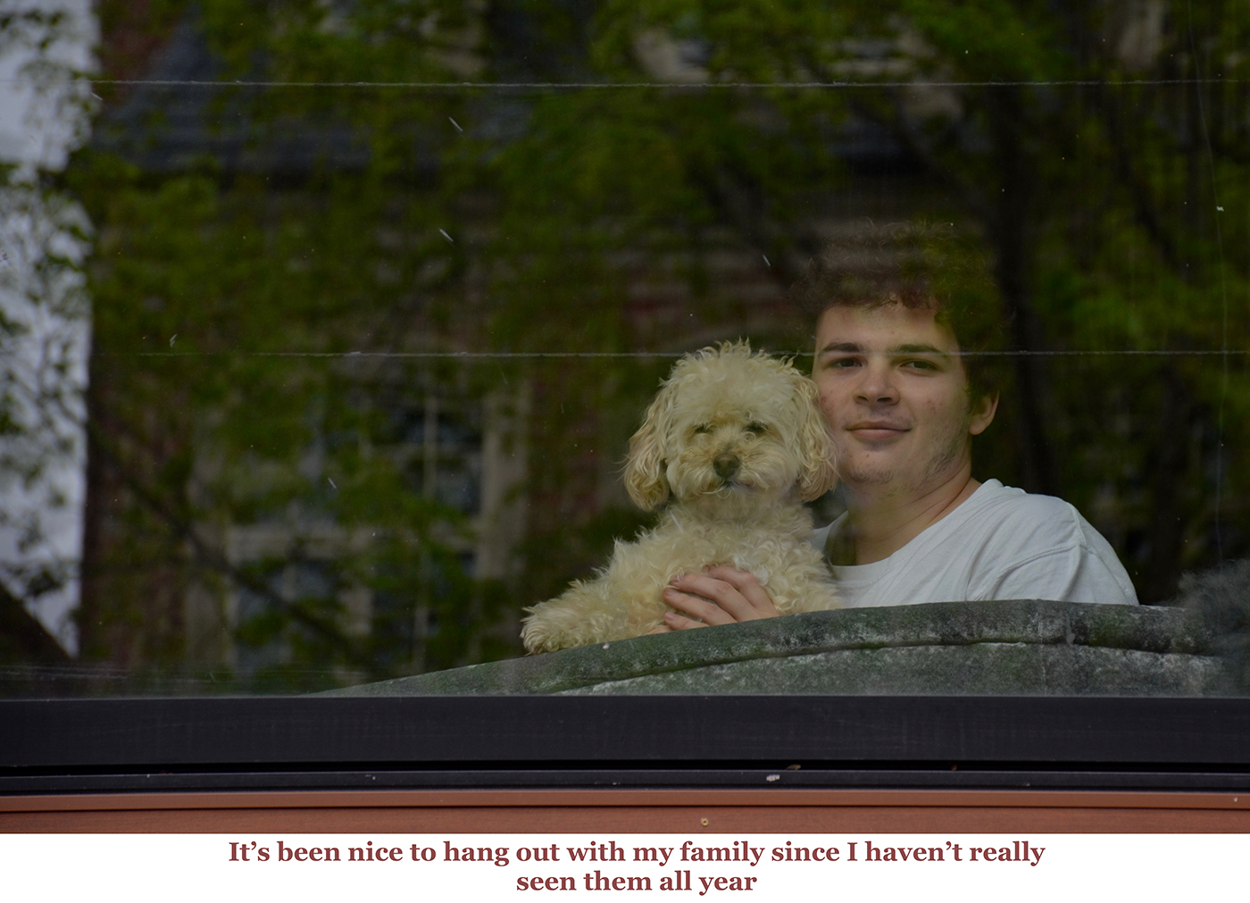 photo of person and dog at window