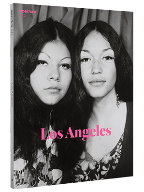 "magazine cover. text ""Los Angeles"" over black and white photograph of two women."