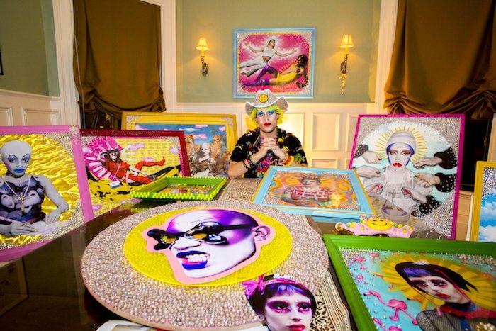 Nicky Ottav sits among his works of arts