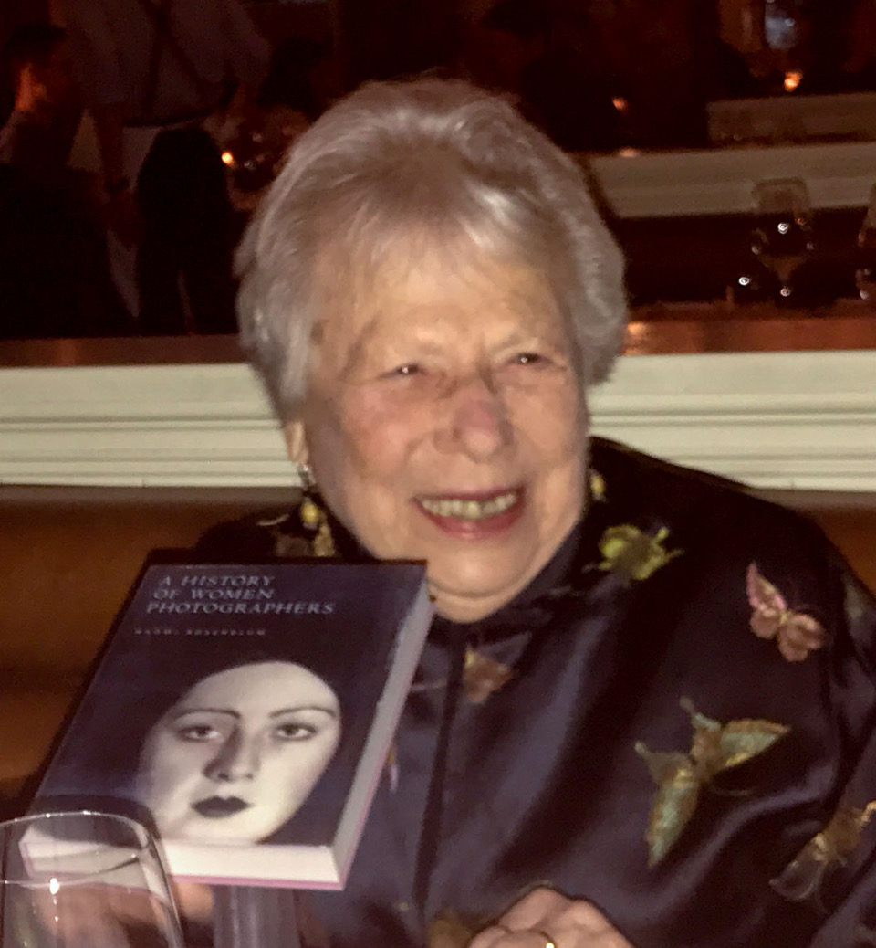 "naomi rosenblum hold her book ""a history of women photographers"""