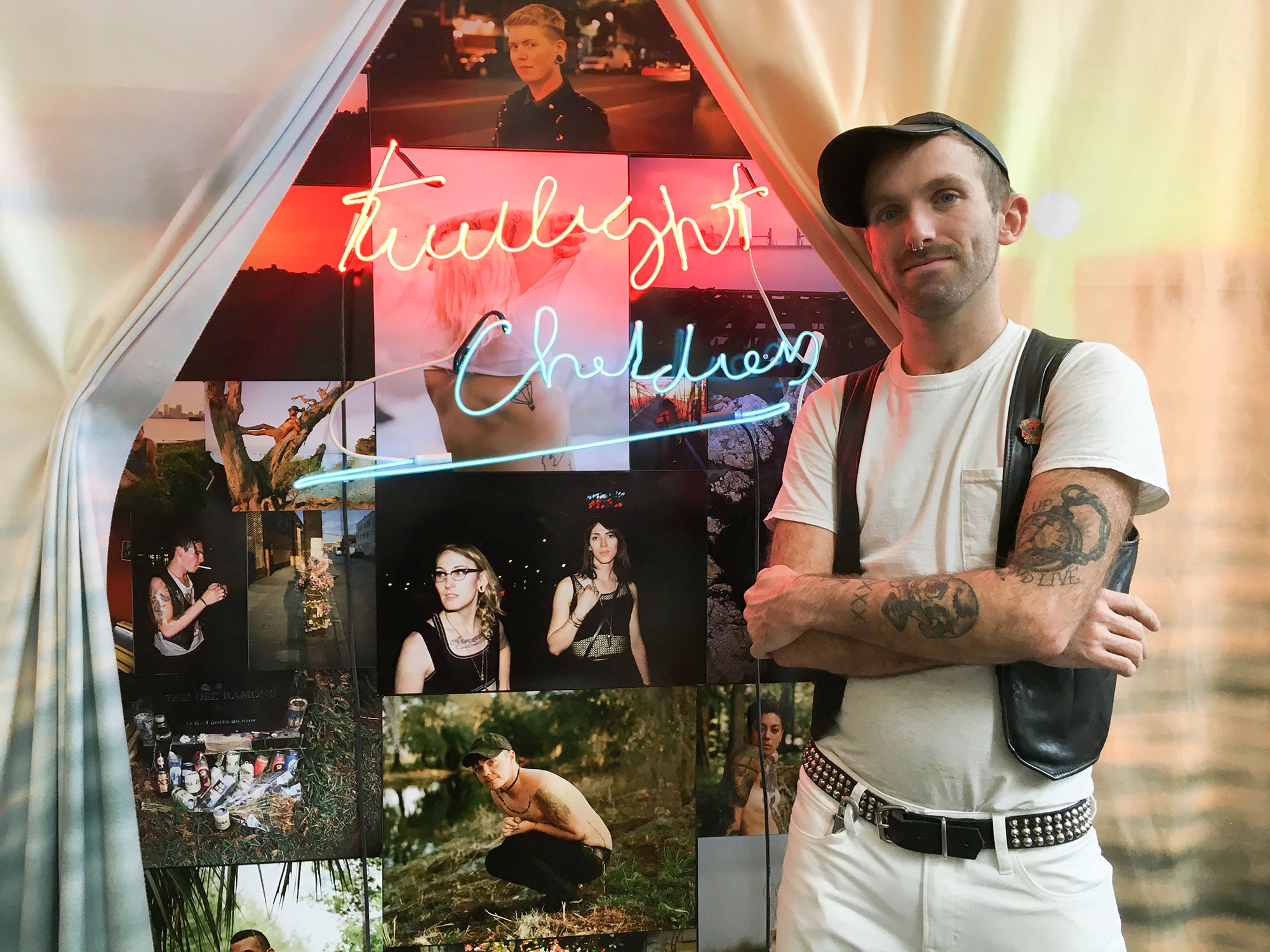 "chris berntsen with neon ""twilight children"" sign"