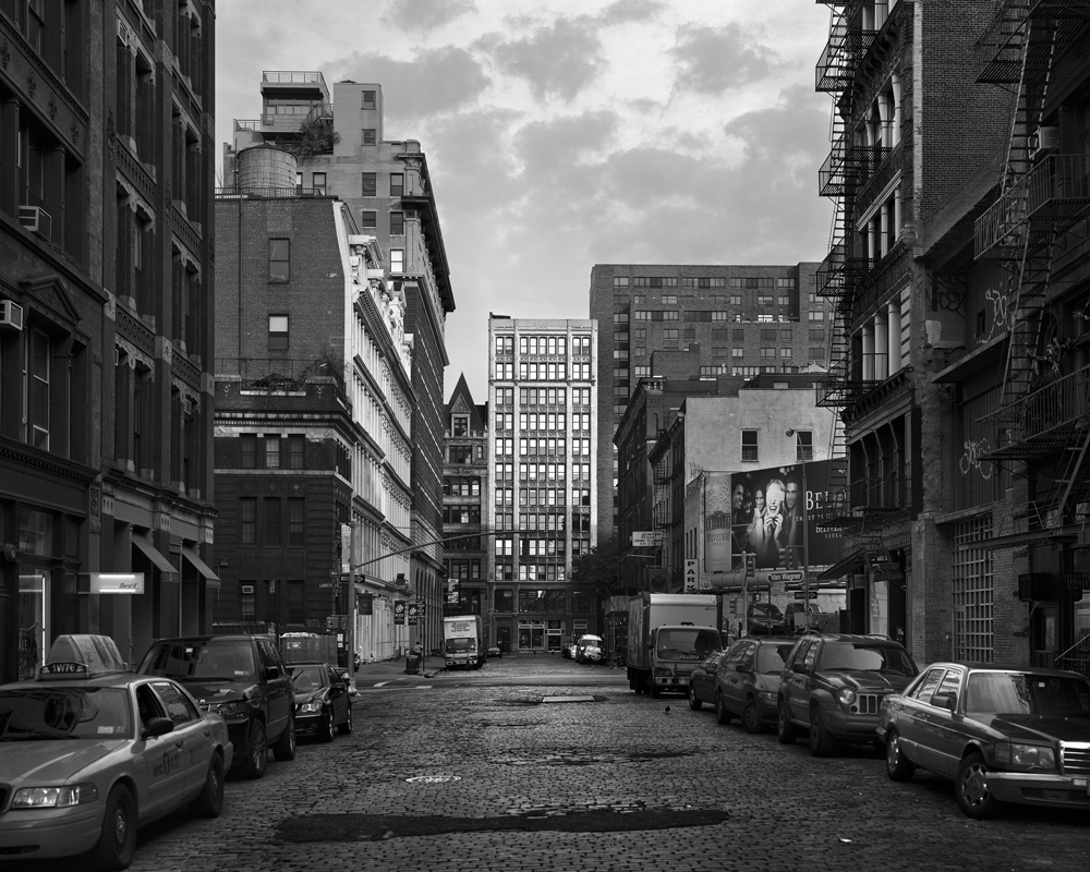 b&w image of nyc street with cobblestones