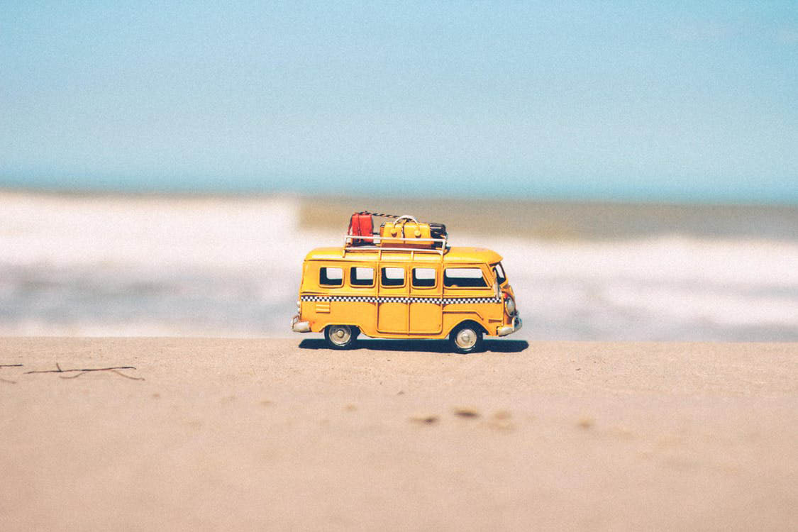 Photo of school bus on the beach.