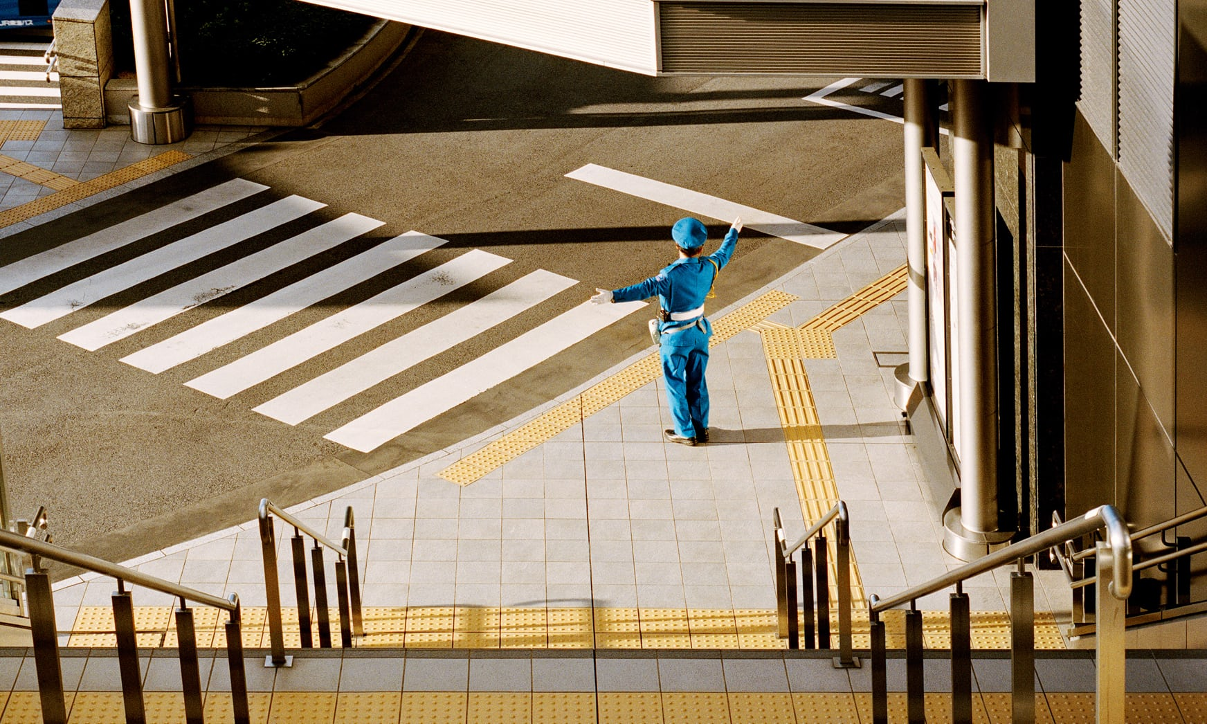 man directing traffic in japan shot from above