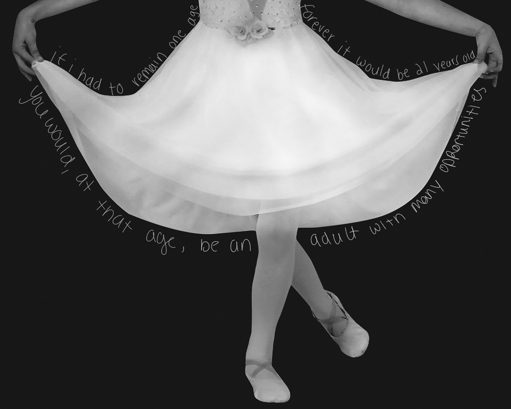 black and white photo of a ballerina in tutu