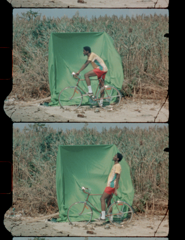 environmental portrait of a greenscreen background with cyclist