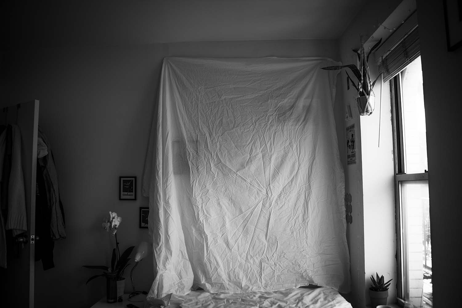 bw photo of bedroom window light on fabric