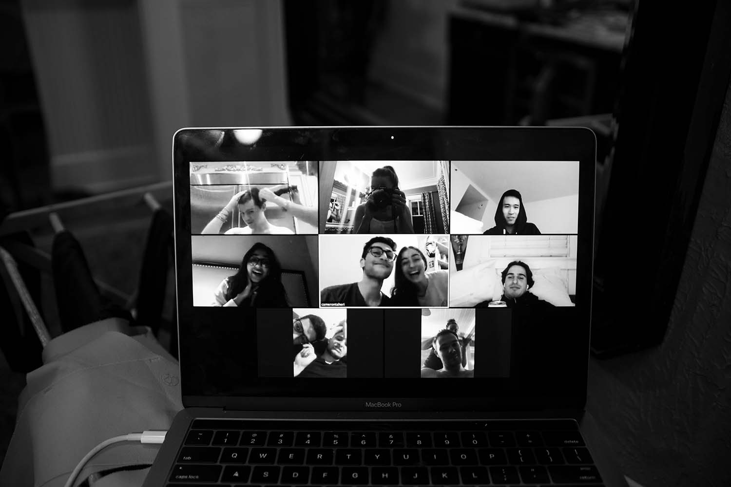 BW photo of zoom video conference on laptop