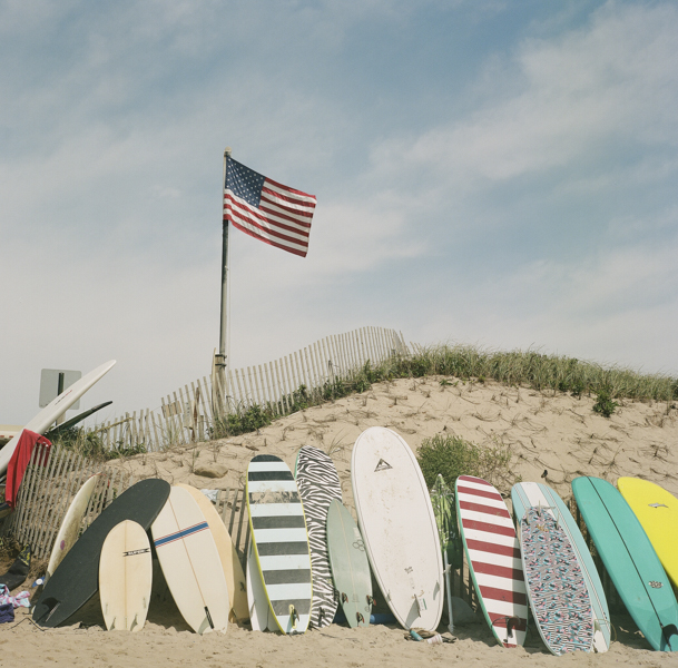 surfboards lined up along a beach