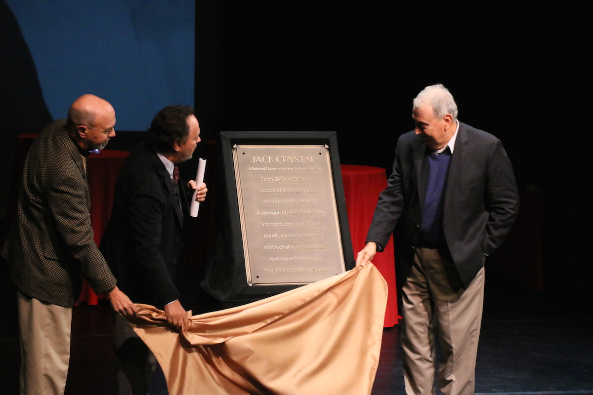 Rip Crystal, Billy Crystal, and Joel Crystal unveil the plaque commemorating their dad, Jack Crystal