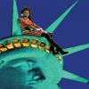 a black woman sits atop the Statue of Liberty
