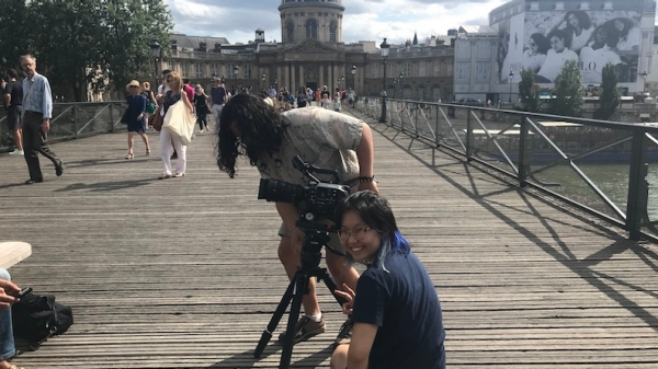 Students shooting on the Pont des Arts in Paris.