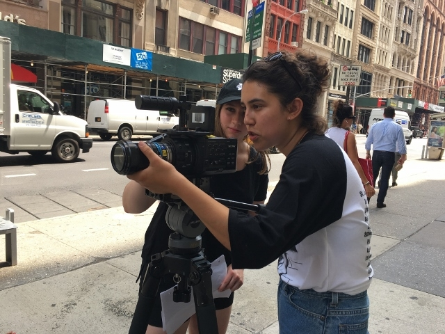 Two women filmmakers setting up a shot on the street in New York