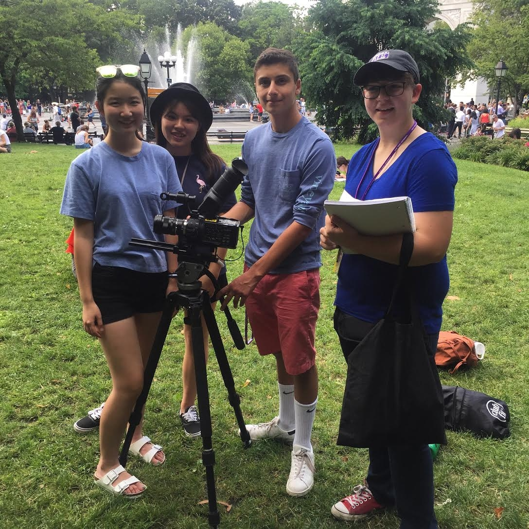 Students shooting a film project in Washington Square Park.