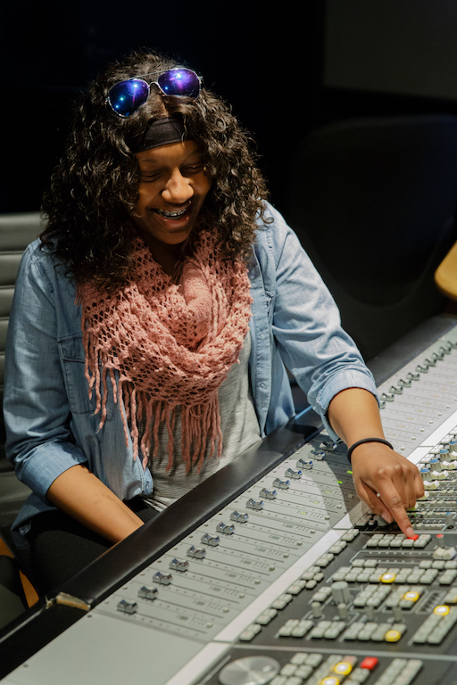 Student at a mixing board at the Clive Davis Institute of Recorded Music