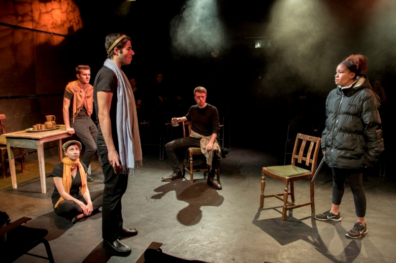 Actors presenting Henry IV on stage.