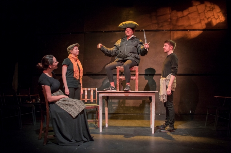 Actors on stage, performing a scene from Henry IV.