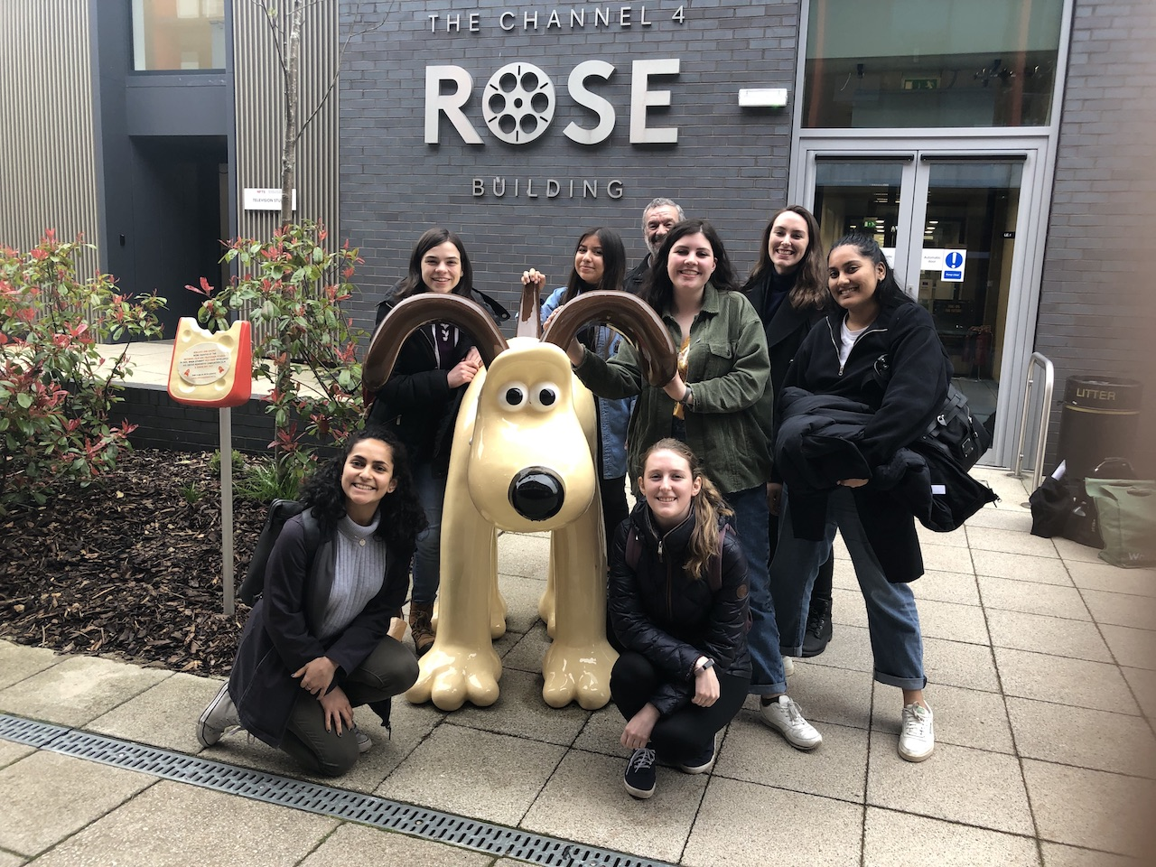 Group photo of the spring 2019 class with a statue of Gromit in front of the Channel 4 Rose Building