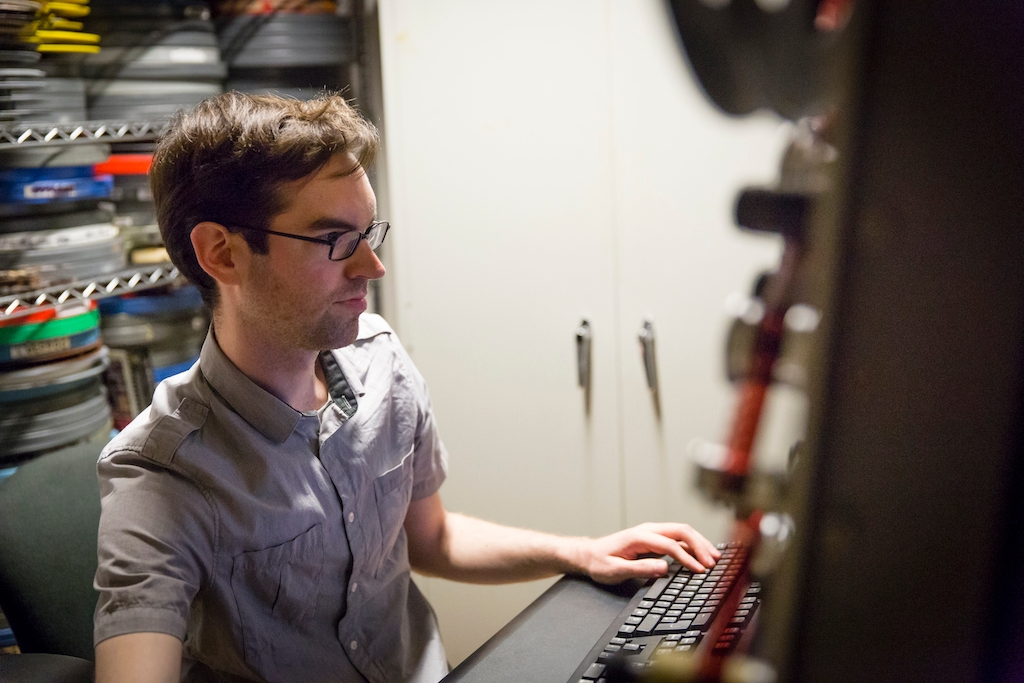 Student working at a computer in the Cinema Studies department