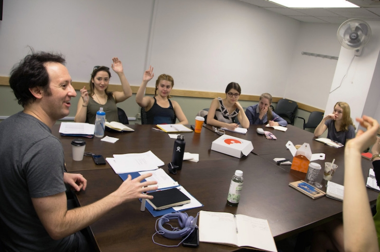 Students at a table read
