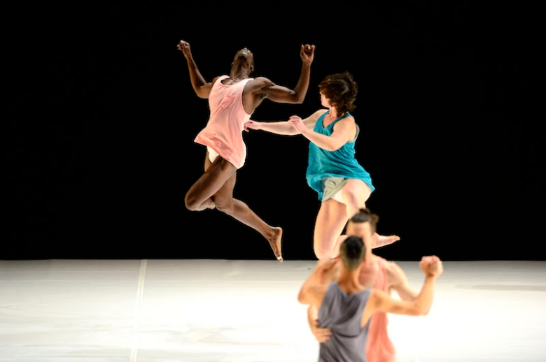 Dancers jumping in mid-performance