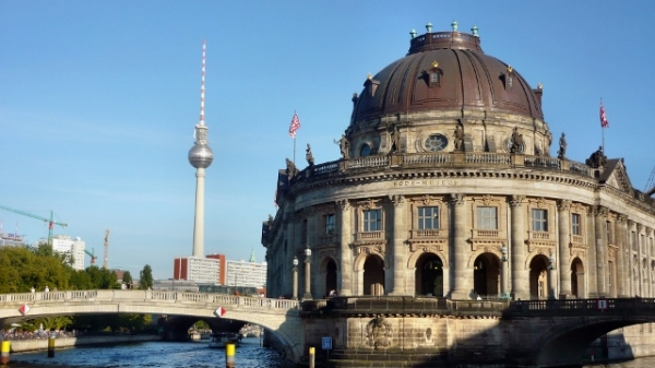 Image of a Berlin landmark and river, including the Berlin TV Tower.