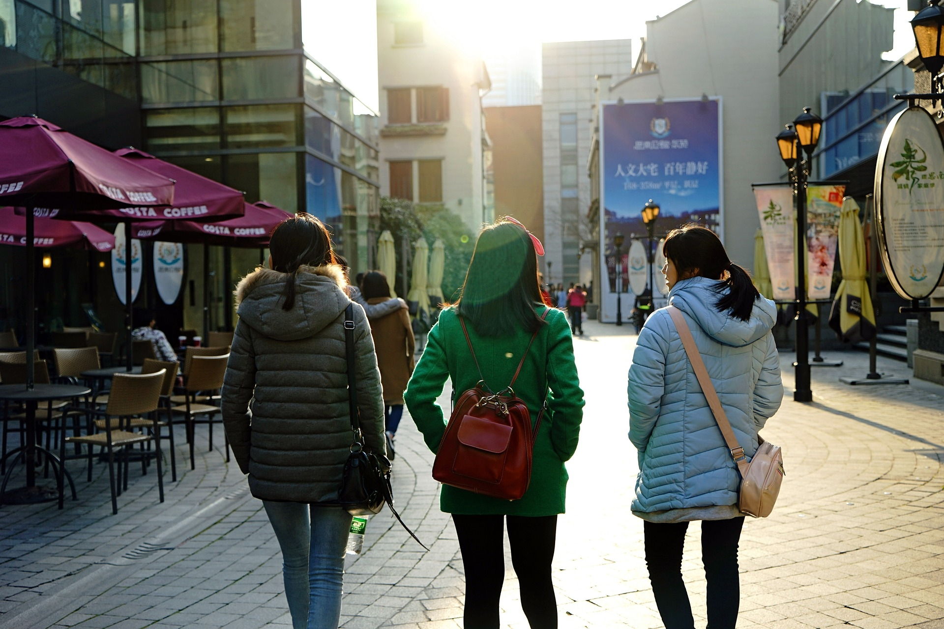 Three Chinese women walking in Shanghai, backs to the camera