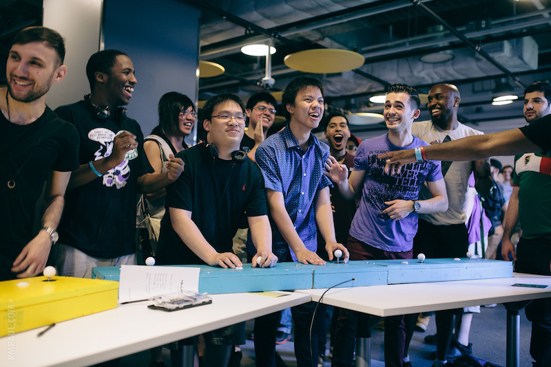 Group of NYU Game Center students playing video games.