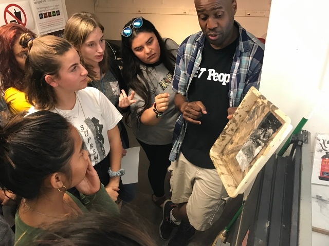 Photography instructor Bayete Ross Smith teaching Tisch Summer High School Photography students.