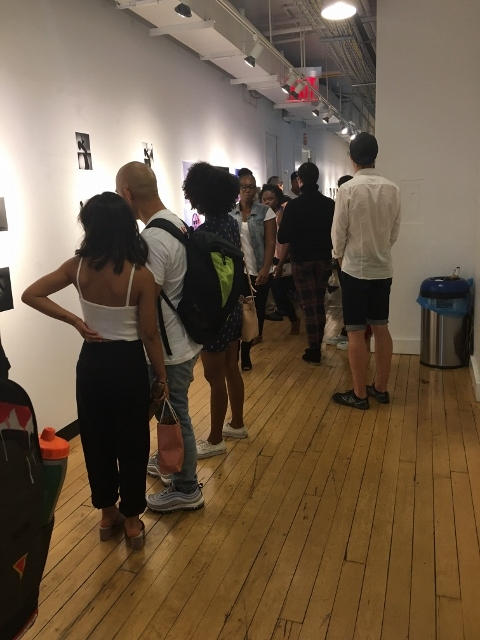 Students browsing the Photography & Imaging Final Gallery Exhibit.