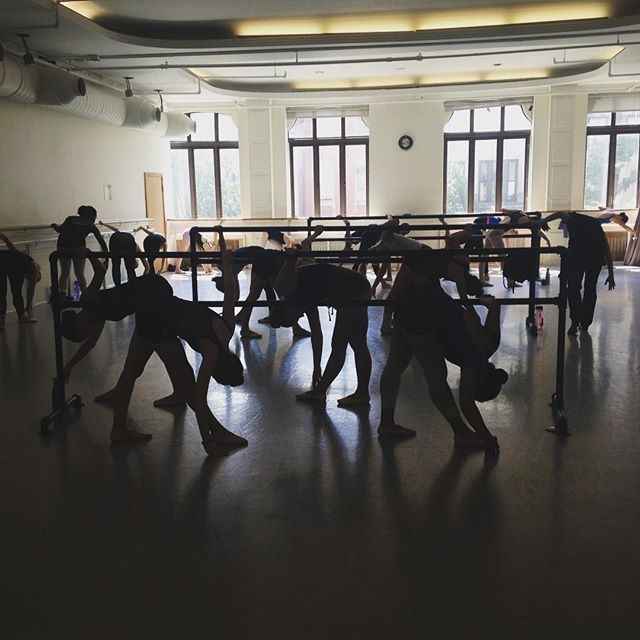 Dancers at the barre in a ballet studio class