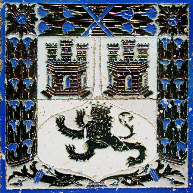 Blue, white, and grey family crest with lion painted ceramic tiles in Havana.