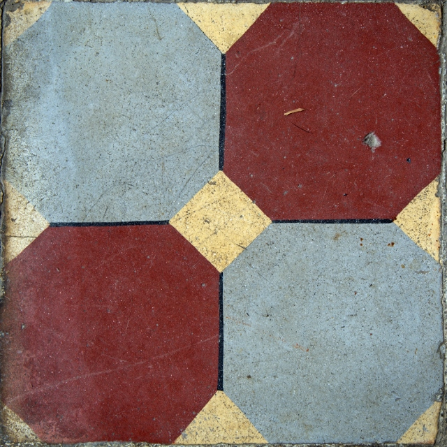 Red and blue octagonal ceramic tiles painted on a gold background.