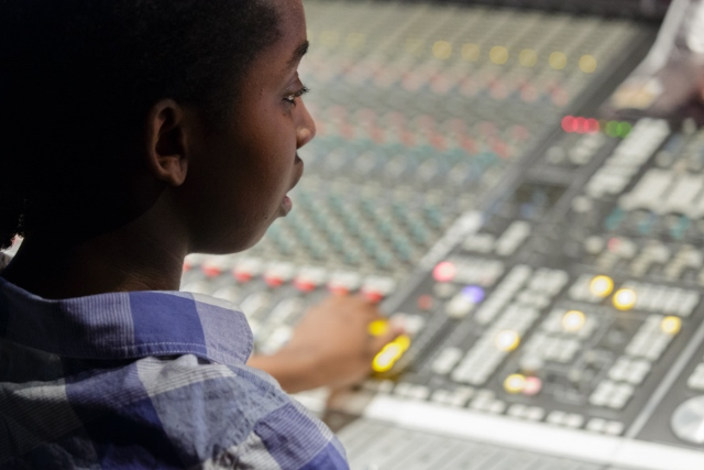 Student at a Mixing Board